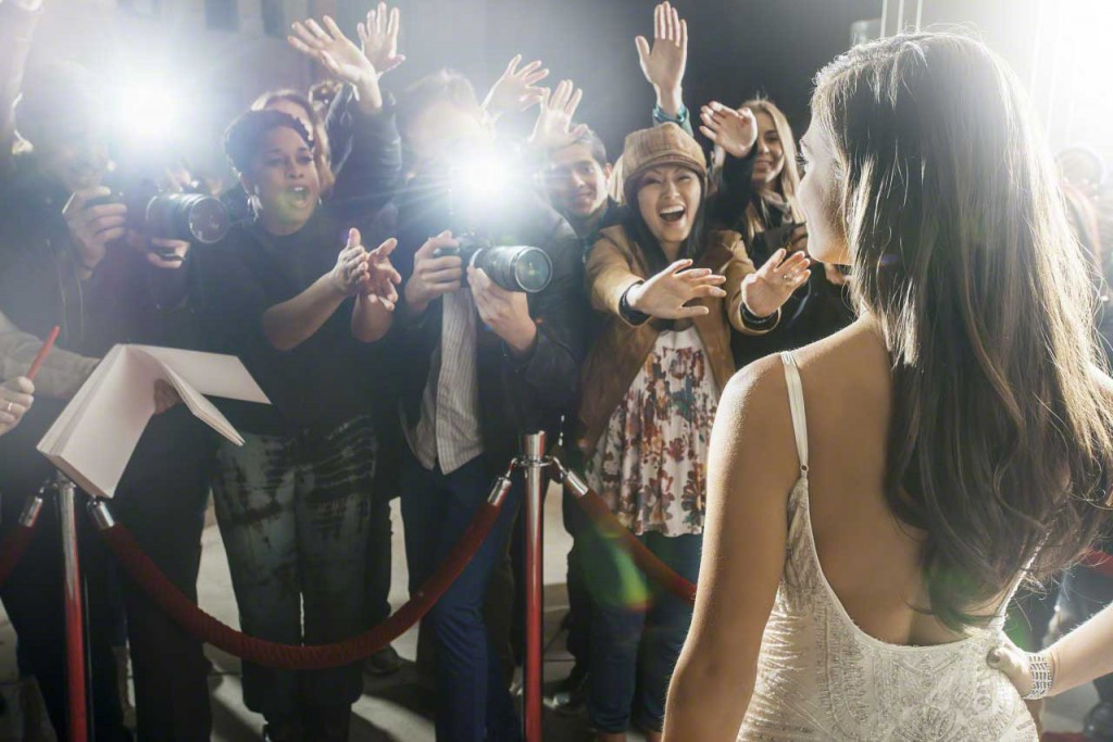 Paparazzi photographing celebrity at red carpet event